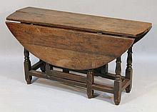 An oak plank top drop leaf table, the D-end top,