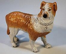 A Staffordshire earthenware figure, of a dog in s