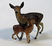 An Austrian cold painted figure group, of a hind