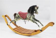 A black and grey painted rocking horse, overall length 6ft 11in.
