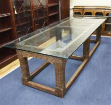 An 18th century and later Continental carved oak refectory table, oak plank top L.9ft 2in. W.3ft