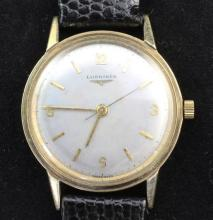 A gentleman's early 1960's 9ct gold Longines manual wind wrist watch,