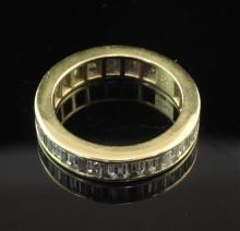 An 18ct gold and diamond full eternity ring, size K.