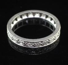 A platinum and diamond full eternity ring, size Q.