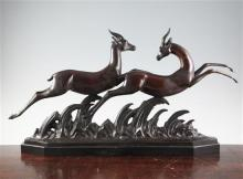 Lucien Charles Alliot (1877-1967) An Art Deco bronze group of two running gazelles, length 29in.