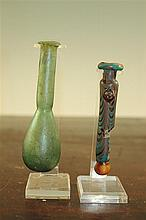 Two Roman glass unguentarium, c. 2nd century A.D., 10.5 and 12cm