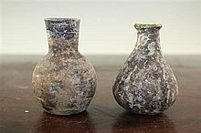 Two Syrian glass gourd flasks, c.6th century A.D., 8.5cm