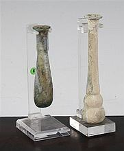 Two Roman glass unguentarium, c, 2nd century A.D., 12 and 9cm