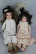 An Armand Marseille bisque headed doll & another similar