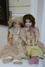 An Armand Marseille bisque headed doll & another doll