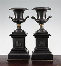 A pair of late 19th century bronze and ormolu campana shaped urns, 12in.