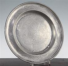 An 18th century pewter dish, 13.25in.