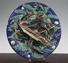 A Palissy style faience dish, late 19th century, 38cm., slight restorations