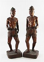 A pair of large Balinese teak figures of native men, first half 20th century, 123cm. and 126cm.