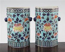 A pair of Chinese enamelled porcelain wall pockets, Qianlong period, 14.3cm., some damage