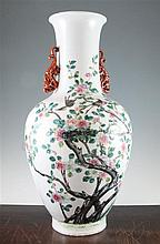 A large Chinese famille rose twin handled bottle vase, Qianlong seal mark, late 19th century, 54cm., foot ground off in manufacture