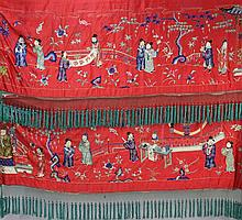 A Chinese embroidered silk red satin panel, early 20th century, approx. 66 x 410cm.