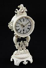A 19th century French carved ivory boudoir timepiece, 6.5in.