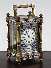 A late 19th century French gilt brass and champleve enamel hour repeating carriage alarum clock, 4.75in., with travelling case