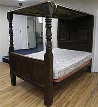 A 17th century carved oak tester bed, W.4ft 6in. H.6ft 1in. L.7ft 2in.