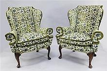 A pair of Queen Anne style wingback armchairs,