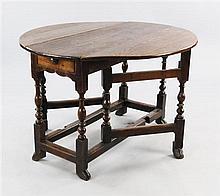 A Queen Anne oval oak gateleg table, extended W.3ft 3in.