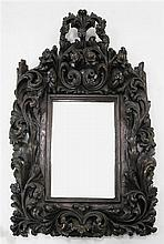 A 17th / 18th century Portuguese baroque carved chestnut wall mirror, 3ft 10in. x 2ft 8in.