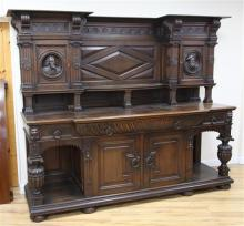 A late 19th century large carved oak breakfront sideboard, W.7ft 9in.
