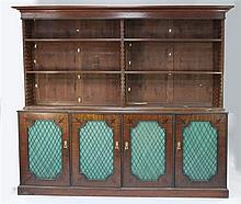 A 19th century mahogany bead moulded and ebony line inlaid bookcase, W.7ft 6in.