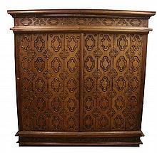 A large Burmese carved hardwood cabinet, W.7ft 4in.