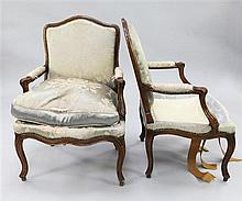 A pair of Louis XV provincial French beech framed fauteuils,