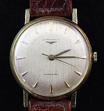 A gentleman's early 1960's 18ct gold Longines automatic wrist watch,