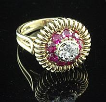 A 1960's? continental gold, diamond and synthetic ruby target dress ring, size P