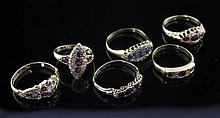 Six late 19th/early 20th century gem set dress rings, various sizes.