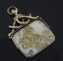 A gold mounted gold veined white quartz spinning fob, overall 2.25in.