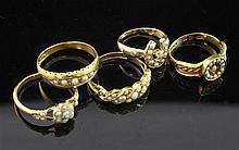 Five gem set rings.