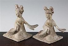 Two Chinese pottery seated figures of ladies, probably Tang dynasty, height 18cm, repairs