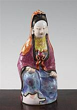 A Chinese famille rose enamelled porcelain seated figure of Guanyin, Jiaqing period, 21cm