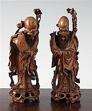 Two Chinese boxwood standing figures of Shou Lao, 20th century, 19.5cm and 20cm