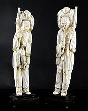 A pair of tall Chinese ivory figures of a fisherman and his wife, first half 20th century, 37cm excl. wood stands