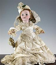 A late Victorian bisque head doll,