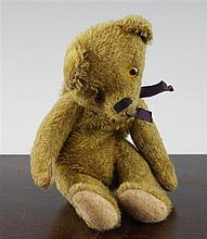 A 20th century teddy bear purse, 9in.