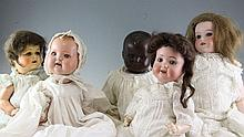 An Armand Marseille No.590 bisque head doll & 4 others