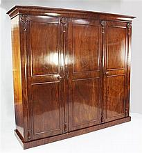A late Victorian mahogany triple wardrobe, W.7ft 4in.