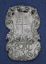 A late 17th century cartouche shape armorial wall plaque, 15.25 x 9.5in.