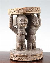 A Yoruba carved wood stool, height 11in.