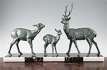 A French Art Deco patinated bronze group modelled as a family of three deer, 27.5in.