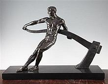 Maurice Guiraud-Riviere (French, b.1881). A patinated bronze model of a male figure working a tiller, 24.5in.
