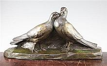 A French Art Deco patinated bronze model of two doves, 25.5in.