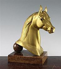 Herbert Heseltine (American, 1877-1962). A gilt bronze horse head, 'Naziri', 13.5in. incl. brown jasper plinth